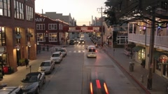 Time lapse at dusk of tourists on historic Cannery Row in Monterey, California. - stock footage