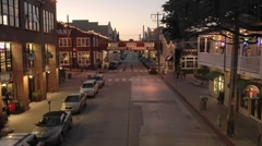 Fast time lapse at dusk of tourists on historic Cannery Row in Monterey - stock footage