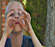 Cute blonde little boy making funny faces 2 Stock Footage