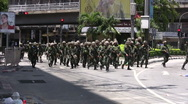 Stock Video Footage of TROOPS SOLDIERS AVANCE FORWARD Move Confront Protesters Rioters