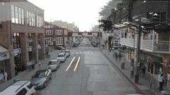 Stock Video Footage of Evening time lapse of tourists shopping on historic Cannery Row in Monterey