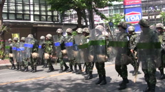 TROOPS SOLDIERS AVANCE FORWARD Move Confront Protesters Rioters - stock footage