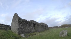 Panning time lapse of clouds blowing over the ruins in Glencolumbkille, County Stock Footage