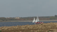 Dinghies turn in formation on Rutland Water. - stock footage