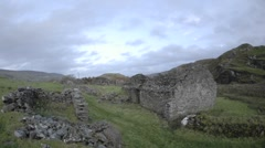 Time lapse of clouds blowing over the ruins in Glencolumbkille, County Donegal - stock footage