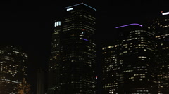 City Buildings at Night Pan Stock Footage