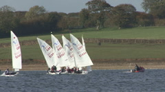 Sail training - dinghies tack to and fro on Rutland Water. - stock footage