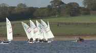 Sail training - dinghies tack to and fro on Rutland Water. Stock Footage