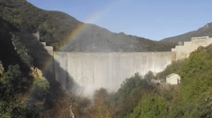 Time lapse of rainbow moving across water spilling over the Matilija Dam Stock Footage
