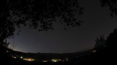 Night time lapse of startrails below an oak tree above Oak View, California. Stock Footage