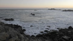 Time lapse of waves breaking on the rocks at Point Pinos at sunrise Stock Footage