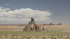 Time lapse of clouds passing over Church Rock Stock Footage