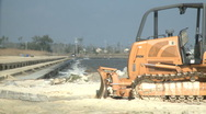 Bull Dozer on Gulf of Mexico shoreline Stock Footage