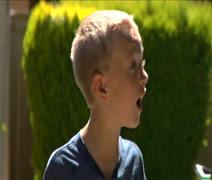 Cute impatient little boy waits for father Stock Footage