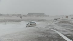 Nasty winter storm, extreme cold, blizzard highway traffic car slid off highway Stock Footage