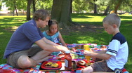 Young single father and kids at Family Picnic in a park Stock Footage