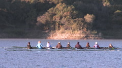 Panning of an eight person rowing sweep on Lake Casitas in Oak View, California. - stock footage