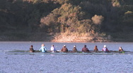 Panning of an eight person rowing sweep on Lake Casitas in Oak View, California. Stock Footage