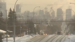 City skyline very cold winter day with traffic long shot, ice fog hanging Stock Footage