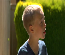 Little boy yells  for Mom to hurry Stock Footage