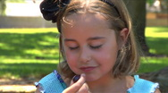 Little girl eats grapes on family picnic Stock Footage