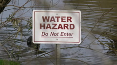 Water Hazzard Sign On Lake  - stock footage