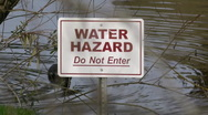 Stock Video Footage of Water Hazzard Sign On Lake