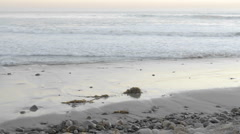 Time lapse of waves washing on shore at sunset in Ventura, California. Stock Footage