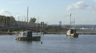 Stock Video Footage of Boats moored to buoys move on wind - Rutland Water.
