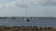 Stock Video Footage of Yacht moored to buoy on Rutland Water turns on wind.