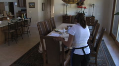 Cleaning woman cleans dining room table in real time - stock footage