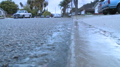 Water running off the sidewalk after a rain in Oak View, California. Stock Footage