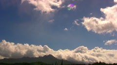 Hawaii timelapse of clouds over distant mountain - stock footage