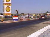 Stock Video Footage of motorsports, drag racing, Chevy vs Maverick, loud and fast!