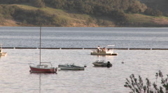 Boat leaving the harbor on Lake Casitas Recreation Area in Oak View, California. Stock Footage