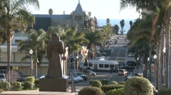 Side view of cars driving in downtown Ventura, California. Stock Footage