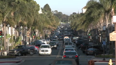 Cars driving on Main Street in downtown Ventura, California. Stock Footage