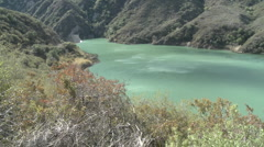 Panning wide view of water behind the Matilija Dam in Ojai, California. Stock Footage