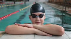 Young Boy in the swimming pool Stock Footage