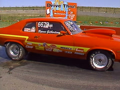 motorsports, drag racing, orange Nova burnout, loud and fast! - stock footage