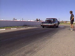 motorsports, drag racing, black Nova burnout, loud and fast! - stock footage
