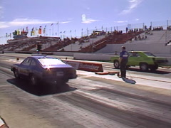 motorsports, drag racing 1977 Mustang vs 73 Dodge dart race, loud! - stock footage
