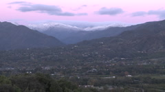 Zoom in of sunrise on the snow-covered Santa Ynez Mountains above Ojai, Stock Footage