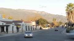 Time lapse of sunset on the Topa Topa Mountains and cars in downtown Ojai Stock Footage