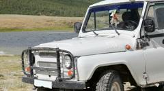 Jeep at coastline of Dayan Nuur lake Stock Footage