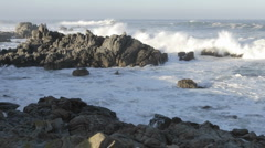 Wide time lapse of waves breaking on the rocks at Point Pinos in Pacific Grove Stock Footage