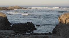 Panning time lapse of waves breaking on Point Pinos in Pacific Grove Stock Footage