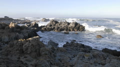 Wide panning time lapse of waves breaking on the rocks at Point Pinos Stock Footage