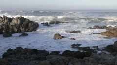 Panning time lapse of waves breaking on the rocks at Point Pinos  Stock Footage