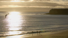 Zoom in time lapse of sun setting over the Pacific Ocean at Refugio Beach State Stock Footage